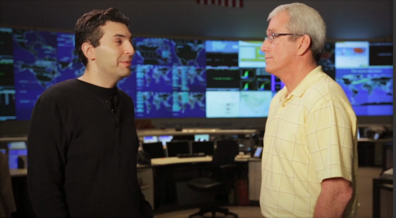 Friedmann and Kerschner in front of the video wall of the AT&T GNOC (click image for video)